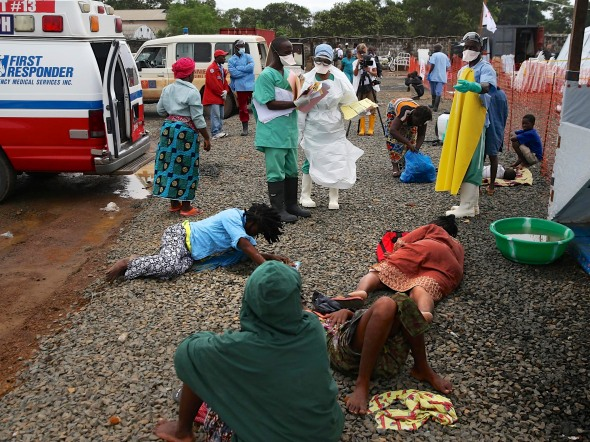 Ebola victims lay on the road, waiting to be treated, in Liberia.